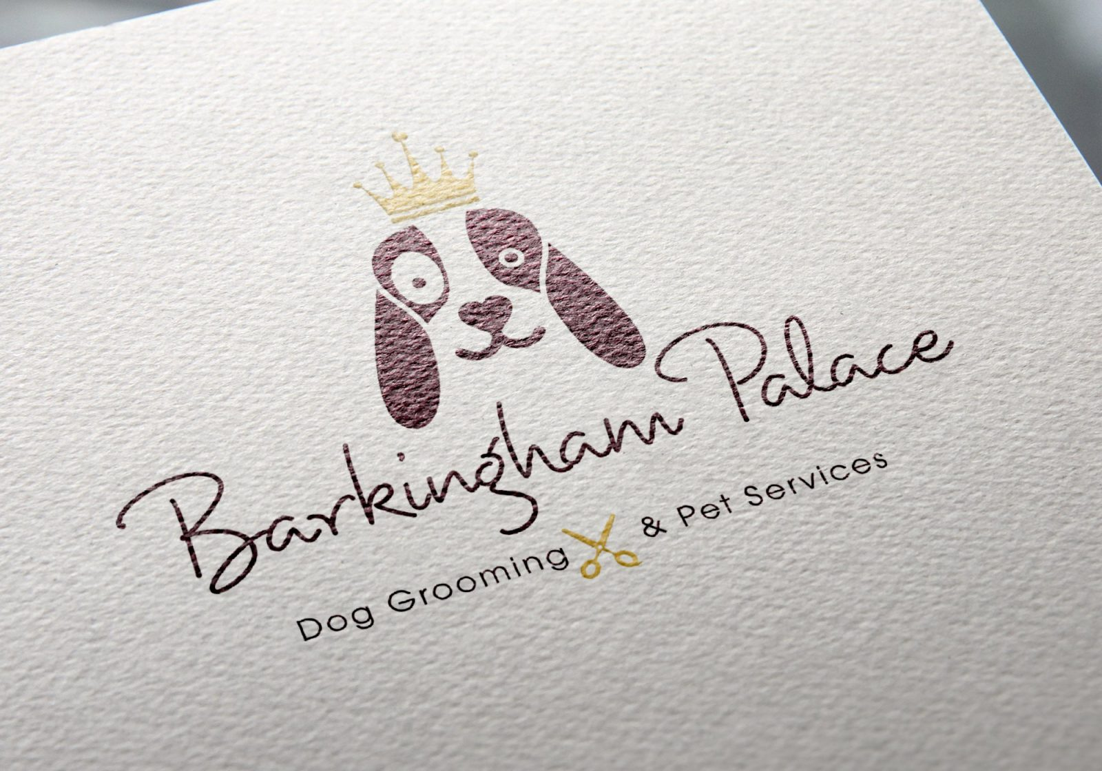 Close up of a Logo on letterhead paper for Barkingham Palace dog grooming services