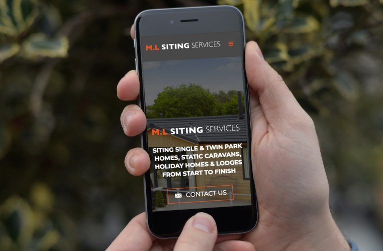 A phone showing the home page of the website design for M.L Siting Services
