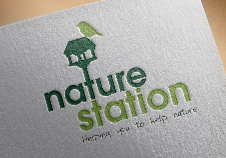 A close up of a letterhead showing the logo for Nature Station