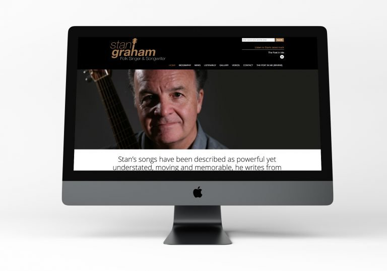 A computer showing the home page design for Stan Graham, singer songwriter's website